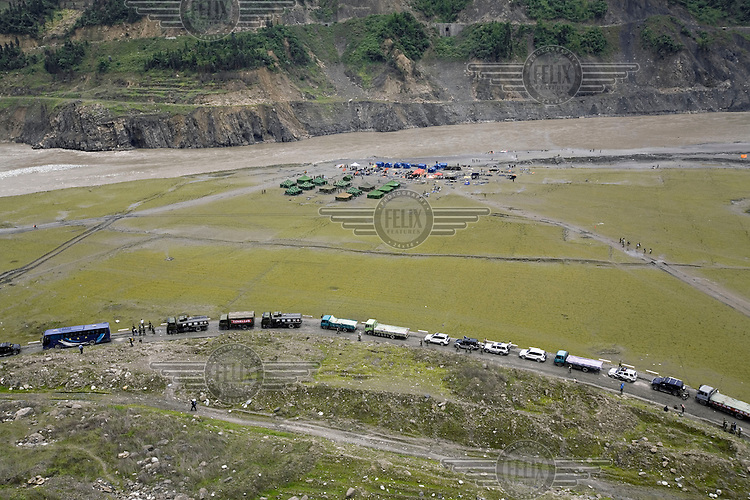 The road to Yinxiu is so damaged that dirt tracks have to be used for transporting the army and rescue teams after the recent Sichuan earthquake of 12/05/2008, which measured 8.0 on the Richter scale. As the rescue effort goes on the death toll continues to rise, with five million people left homeless in Sichuan.