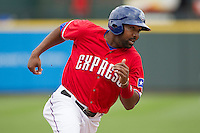 Round Rock Express designated hitter Joey Butler #16 rounds third base against the Omaha Storm Chasers in the Pacific Coast League baseball game on April 7, 2013 at the Dell Diamond in Round Rock, Texas. Omaha beat Round Rock 5-2, handing the Express their first loss of the season. (Andrew Woolley/Four Seam Images).