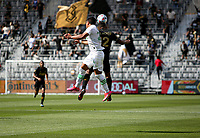 LOS ANGELES, CA - APRIL 17: Nick Lima #24 of Austin FC and Diego Palacios #12 of LAFC battle during a game between Austin FC and Los Angeles FC at Banc of California Stadium on April 17, 2021 in Los Angeles, California.
