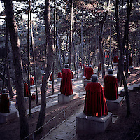 Stone statues of Arhats are draped with red capes at Hongluosi Temple in Beijing, China during the Chinese New Year of the Dragon, January, 2012.