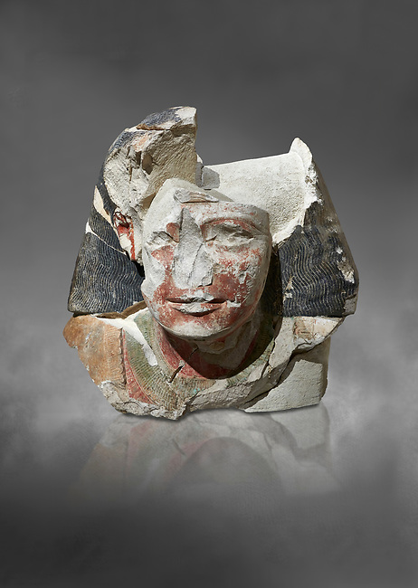 Ancient Egyptian statue head of a monarch, limestone, Middle Kingdom, mis 12th Dynasty, (1900-1850 BC), Qqw el-Kebir, tomb of Ibu. Egyptian Museum, Turin. Grey background.<br /> <br /> Since this statue head comes from the tomb of Ibu it is likely that they depict a powerful gosvenor, although the incsription is lost. It can be dated by its style which is close to the statues of Amenemhat II and Sesostris II. Schiaparelli excavations. Cat 4410 & 4414