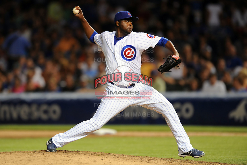 Chicago Cubs pitcher Jairo Asencio #37 delivers a pitch during a game against the Miami Marlins at Wrigley Field on July 17, 2012 in Chicago, Illinois. The Marlins defeated the Cubs 9-5. (Tony Farlow/Four Seam Images).
