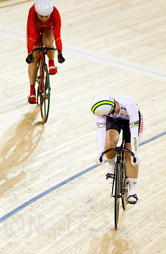 18 FEB 2012 - LONDON, GBR - Australia's Anna Meares (AUS) (on the right, in white and black) watches opponent China's Guo Shuang (CHN) (on left in red and yellow) during the Women's Sprint final at the UCI Track Cycling World Cup and London Prepares test event for the 2012 Olympic Games in the Olympic Park Velodrome in Stratford, London, Great Britain (PHOTO (C) 2012 NIGEL FARROW)