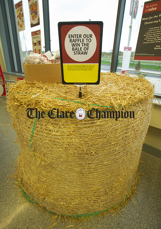 A bale of straw being raffled at Jones SuperValu in Miltown Malbay. Photograph by John Kelly.