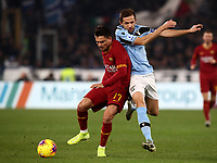 Football, Serie A: AS Roma - S.S. Lazio, Olympic stadium, Rome, January 26, 2020. <br /> Roma's Cengiz Under (l) in action witht Lazio's captain Senad Lulic (r) during the Italian Serie A football match between Roma and Lazio at Olympic stadium in Rome, on January,  26, 2020. <br /> UPDATE IMAGES PRESS/Isabella Bonotto