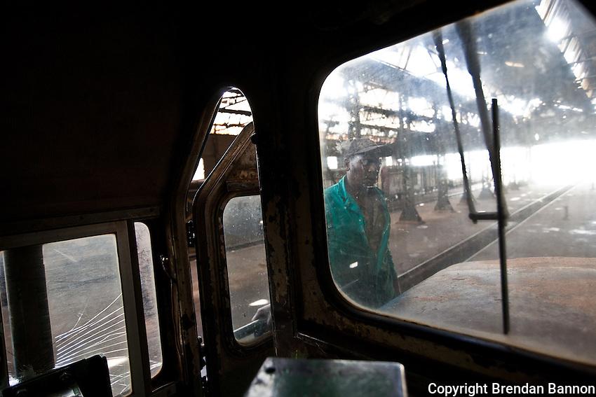 Mechanic Daniel Kamau working on a train in the Locomotive Shed in the Nairobi Railways Station.