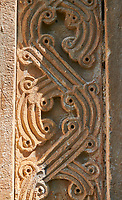 Pictures & Images of the Archangel Georgian Orthodox Church Georgian style exterior relief stone carvings of the south door, 10th - 11th century, Upper Krikhi, Krikhi, Georgia (country).<br /> <br /> For a small church Krikhi Archangel Church is extremely well decorated on the outside with Georgian style bas relief stonework. The south door has intricate carvings along its pillars and in the architraves above the door. The churches small windows are highly decorated with stone tracery around them.