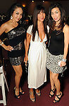 From left: Kristi Nguyen, Mimi Dinh and Ashley Mai Nguyen at the third day of the Fashion Houston 2010 presented by Audi at the Wortham Theater Wednesday Oct. 13, 2010. (Dave Rossman/For the Chronicle)