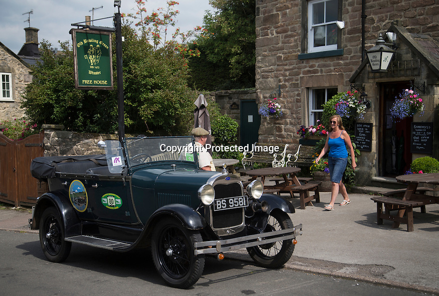 16/08/16<br /> <br /> Debbie Slater climbs into her 'taxi'  outside the Old Bowling Green pub, Winster.<br /> <br /> You'd be forgiven for thinking you'd had one drink too many if you called a cab in this Derbyshire Peak District village, because you'll get a 1929 vintage Model A Ford turn up as it's the only taxi in town!<br /> <br /> Full story here: https://fstoppressblog.wordpress.com/vintage-car-is-the-only-taxi-in-town/<br /> <br /> What's more, it's the oldest vehicle licensed for private hire in the UK, as cars usually have to be less than three years old to get a licence.<br /> <br /> But thanks to a special exemption to get round not having seat belts and the usual modern specifications, this fabulous-looking car is a regular sight pootling around the narrow lanes of the Derbyshire Dales.<br /> <br /> So when Debbie Slater needed a ride home from the Old Bowling Green pub in Winster she knew exactly who to call for an open-top ride in the sunshine.<br /> <br /> All Rights Reserved, F Stop Press Ltd. +44 (0)1773 550665