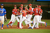 Jordyn Adams (3) of Green Hope High School in Cary, North Carolina is mobbed by teammates - including Blaze Alexander (21), Ethan Hankins (31), Alek Thomas (2), Matthew Liberatore (32), Nolan Gorman (9), and Matt Rudis (19) after hitting a walk off single during the Under Armour All-American Game presented by Baseball Factory on July 29, 2017 at Wrigley Field in Chicago, Illinois.  (Mike Janes/Four Seam Images)