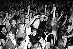 Skinheads in Camden Town at The Electric Ballroom, dancing to UB40 band. London 1980s. Jimmy John, skinhead centre middle giving the Nazi salute, they were what was then called 'Sieg Heiling'.  <br /> Zoe Barnes (nee Johnson) clapping hands in air above head foreground centre. And Zoe's friend Heather Lewis (afro hairstyle and glasses Left bottom.) <br /> The Electric Ballroom, Camden, London a UB40 gig. The British reggae pop band took their name from the Unemployment Benefit, Form 40. The UB40 form no longer exists.