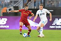 3rd October 2021; Stadio Olimpico, Rome, Italy; Serie A football, AS Roma versus Empoli; Szymon Zurkowski of FC Empoli covers Henrikh Mkhitaryan of As Roma