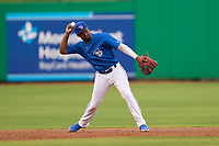 Dunedin Blue Jays shortstop Orelvis Martinez (11) throws to first base during a game against the Bradenton Marauders on May 13, 2021 at BayCare Ballpark in Clearwater, Florida.  (Mike Janes/Four Seam Images)