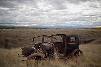An abandoned vintage car stands in a field north of Great Falls, Montana, USA.