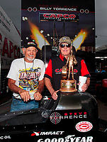 Sep 27, 2020; Gainesville, Florida, USA; Richard Hogan (right) crew chief for NHRA top fuel driver Steve Torrence celebrate with Don Garlits after winning the Gatornationals at Gainesville Raceway. Mandatory Credit: Mark J. Rebilas-USA TODAY Sports