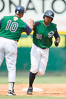 Charlotte Knights manager Chris Chambliss #10 bumps fists with Stefan Gartrell #31 as he rounds third base after hitting a home run against the Toledo Mudhens at Knights Stadium August 8, 2010, in Fort Mill, South Carolina.  Photo by Brian Westerholt / Four Seam Images