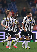 Calcio, Serie A: Roma vs Udinese. Roma, stadio Olimpico, 17 marzo 2014.<br /> Udinese midfielder Giampiero Pinzi, second from right, celebrates with teammates, from left, Dusan Basta, Emmanuel Badu and Antonio Di Natale after scoring during the Italian Serie A football match between AS Roma and Udinese at Rome's Olympic stadium, 17 March 2014.<br /> UPDATE IMAGES PRESS/Isabella Bonotto