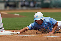 North Carolina outfielder Chaz Frank (2) dives back to first during Game 3 of the 2013 Men's College World Series against the North Carolina State Wolfpack at TD Ameritrade Park on June 16, 2013 in Omaha, Nebraska. The Wolfpack defeated the Tar Heels 8-1. (Andrew Woolley/Four Seam Images)