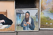 Caricature paintings of Jews for sale in Krakow.  One of a number of ventures set up by local non-Jewish Poles to exploit the city's Jewish history by catering to growing tourist interest in Holocaust memorabilia.
