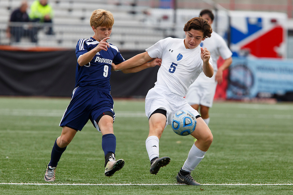 Providence's Alex Lancaster (9) and Mishawaka Marian's Justin Saavedra (5) play the ball during the IHSAA Class A Boys Soccer State Championship Game on Saturday, Oct. 29, 2016, at Carroll Stadium in Indianapolis. Marian won 4-0. Special to the Tribune/JAMES BROSHER