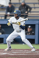 Michigan Wolverines outfielder Christian Bulloock (5) squares to bunt against the Western Michigan Broncos on March 18, 2019 in the NCAA baseball game at Ray Fisher Stadium in Ann Arbor, Michigan. Michigan defeated Western Michigan 12-5. (Andrew Woolley/Four Seam Images)