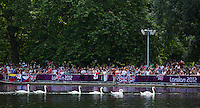 09 AUG 2012 - LONDON, GBR - Swans make their way across The Serpentine as spectators line the banks for the London 2012 Olympic Games women's 10km Marathon Swimming in Hyde Park, London, Great Britain (PHOTO (C) 2012 NIGEL FARROW)