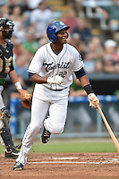 Asheville Tourists first baseman Correlle Prime #32 swings at a pitch during a game against the Savannah Sand Gnats at McCormick Field September 3, 2014 in Asheville, North Carolina. The Tourists defeated the Sand Gnats 8-3. (Tony Farlow/Four Seam Images)