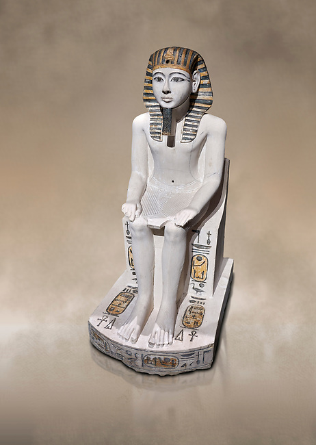 Ancient Egyptian cult statue of Amenhoptep I, limestone, New Kingdom, 19th Dynasty, (1292-1190 BC, Deir el-Medina. Egyptian Museum, Turin. Grey background.<br /> <br /> The cult of Amenhoptep I flourished during the 19th &20th Dynasties. This statue is typical of Theban sculpture of the Ramesside era : large eyes, full cheeks and aquiline nose. the kings skin colour is white rather than the more common red hue. This is typical of other Deir el-Medina statues of the era.  Drovetti collection. Cat 1372.