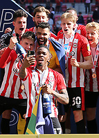 Ivan Toney celebrates winning the Championship Trophy with a selfie during Brentford vs Swansea City, Sky Bet EFL Championship Play-Off Final Football at Wembley Stadium on 29th May 2021