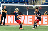 FOXBOROUGH, MA - AUGUST 29: Brandon Bye #15 of New England Revolution heads the ball during a game between New York Red Bulls and New England Revolution at Gillette Stadium on August 29, 2020 in Foxborough, Massachusetts.