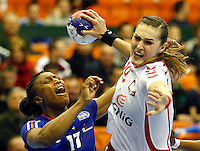 SERBIA, Novi Sad: Poland's Kinga Byzdra (R) vies with France's Siraba Dembele (L) during the Women's Handball World Championship 2013 quarter final match between Poland vs France on December 18, 2013 in Novi Sad.  AFP PHOTO / PEDJA MILOSAVLJEVIC