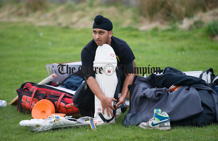 Manvinder Singh puts on the protective wear before the Clare Cricket Club training session at Shannon. Photograph by John Kelly.