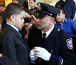 Waterbury, CT-10 April 2012-041012CM10-  Maximo Torres talks to his son Maximo Torres, Jr 9, before his promotion ceremonyTuesday night at the Aldermanic Chambers in City Hall.  Torres was promoted to the rank of detective during the ceremony. Torres has worked for the department for seven years, serving as a patrol officer working high-crime areas. Torres was promoted to fill a vacancy left by the retirement of Timothy Jackson, who is now working as a patrol officer in Wolcott.  Christopher Massa Republican-American