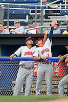 Auburn Doubledays pitcher Anderson Martinez (38) and infielder Chris Riopedre (3) reach for a foul ball during a game against the Batavia Muckdogs on August 31, 2014 at Dwyer Stadium in Batavia, New York.  Batavia defeated Auburn 7-6.  (Mike Janes/Four Seam Images)