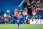 Kevin Kampl (r) of Bayer 04 Leverkusen fights for the ball with Angel Correa of Atletico de Madrid during their 2016-17 UEFA Champions League Round of 16 second leg match between Atletico de Madrid and Bayer 04 Leverkusen at the Estadio Vicente Calderon on 15 March 2017 in Madrid, Spain. Photo by Diego Gonzalez Souto / Power Sport Images