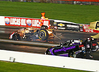 Sep 3, 2016; Clermont, IN, USA; NHRA funny car driver Robert Hight (left) slides sideways on fire after an engine explosion alongside Dave Richards during qualifying for the US Nationals at Lucas Oil Raceway. Hight was uninjured in the explosion. Mandatory Credit: Mark J. Rebilas-USA TODAY Sports