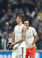 Football Soccer: UEFA Champions League Juventus vs Sporting Clube de Portugal, Allianz Stadium. Turin, Italy, October 18, 2017. <br /> Juventus' Mario Mandzukic (l) and Gianluigi Buffon (r) celebrate after winning 2-1 the Uefa Champions League football soccer match between Juventus and Sporting Clube de Portugal at Allianz Stadium in Turin, October 18, 2017.<br /> UPDATE IMAGES PRESS/Isabella Bonotto