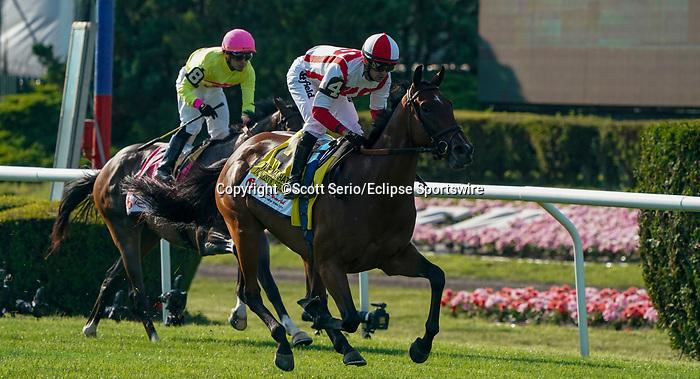 June 5, 2021: Domestic Spending, #4, ridden by jockey Flavien Prat, wins the resorts World Casino Manhatten Stakes on Belmont Stakes Day at Belmont Park in Elmont, New York. Scott Serio/Eclipse Sportswire/CSM