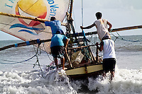 Brazilian fishermen (jangadeiros) put out to sea on the beach of Uruaú, Ceará state, northeastern Brazil, 16 March 2004. Jangadeiros, working on a unique wooden raft boat called jangada, keep the tradition of artisan fishing for more than four hundred years. However, being a fisherman on jangada is highly dangerous job. Jangadeiros spend up to several days on high-sea, sailing tens of kilometres far from the coast, with no navigation on board. In the last two decades jangadeiros have been facing up the pressure from motorized vessels which use modern, effective (and environmentally destructive) fishing methods. Every time jangadeiros come back from the sea with less fish.
