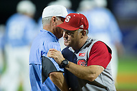 North Carolina State Wolfpack head coach Elliott Avent (right) hugs North Carolina Tar Heels head coach Mike Fox following the conclusion of Game Twelve of the 2017 ACC Baseball Championship at Louisville Slugger Field on May 26, 2017 in Louisville, Kentucky.  The Tar Heels defeated the Wolfpack 12-4 to advance to the semi-finals.  (Brian Westerholt/Four Seam Images)