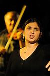 PARADIS TZIGANE..CIRQUE ROMANES..Auteur : Cirque ROMANES..Avec :..ROMANES Delia:chant..ROMANES ALEXANDRE:chant..COSTEL:violon..DANGALAS:contrebasse..GIGEL:clarinette..MARIUS:accordeon..BETTY funambule..MARIA:contorsion..ALEXANDRA FLORINA ROSE:trapeze..KALI:ruban..FLORINA YVAN ARAMIS:jonglage..IRINA:cerceau..MICA LENUTA BOBOLANA GOULOUM:danse..DORIN DOREL SORIN ALIN CATALIN:aerien..Lieu : Chapiteau du Cirque Tsigane Romanes..Ville : Paris..Le : 28 11 2009..© Laurent PAILLIER / photosdedanse.com..All rights reserved