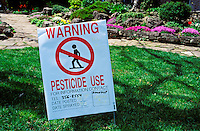 Pesticide use warning sign on lawn