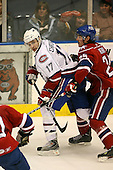 March 15, 2009:  Center Kyle Chipchura (17) of the Hamilton Bulldgos, AHL affiliate of Montreal Canadians, is defended by Jordan Henry (25) during the third period of a regular season game at the Blue Cross Arena in Rochester, NY.  Hamilton defeated Rochester 4-3 in a shoot out.  Photo Copyright Mike Janes Photography 2009