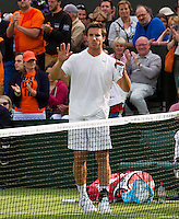 25-06-13, England, London,  AELTC, Wimbledon, Tennis, Wimbledon 2013, Day two, Igor Sijsling (NED) wins his first round and thanks the crowd<br /> <br /> <br /> <br /> Photo: Henk Koster