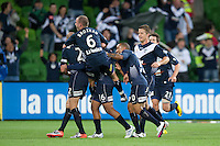 MELBOURNE, AUSTRALIA - NOVEMBER 18: Carlos Hernandez of the Victory celebrates his goal with team mates during the round 14 A-League match between the Melbourne Victory and Central Coast Mariners at AAMI Park on November 18, 2010 in Melbourne, Australia (Photo by Sydney Low / Asterisk Images)