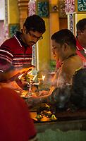 Hindu Priest and Worshipers, Sri Mahamariamman Hindu Temple, Kuala Lumpur, Malaysia.