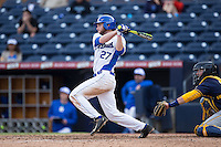 Evan Dougherty (27) of the Duke Blue Devils follows through on his swing against the California Golden Bears at Durham Bulls Athletic Park on February 20, 2016 in Durham, North Carolina.  The Blue Devils defeated the Golden Bears 6-5 in 10 innings.  (Brian Westerholt/Four Seam Images)