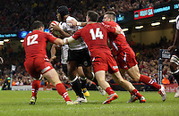 Pictured: Jamie Roberts (L) and Alex Cuthbert (14) of Wales bring down a Fiji player. Saturday 15 November 2014<br />