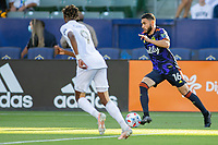 CARSON, CA - JUNE 19: Alex Roldan #16 of the Seattle Sounders FC moves with the ball during a game between Seattle Sounders FC and Los Angeles Galaxy at Dignity Health Sports Park on June 19, 2021 in Carson, California.