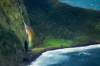 Small unnamed waterfall with rainbow. Waipio Valley Overlook. Hawaii, The Big Island